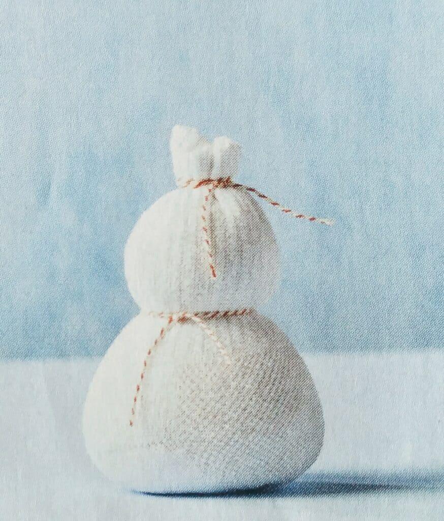 Popje of sneeuwpop maken met sok en touw